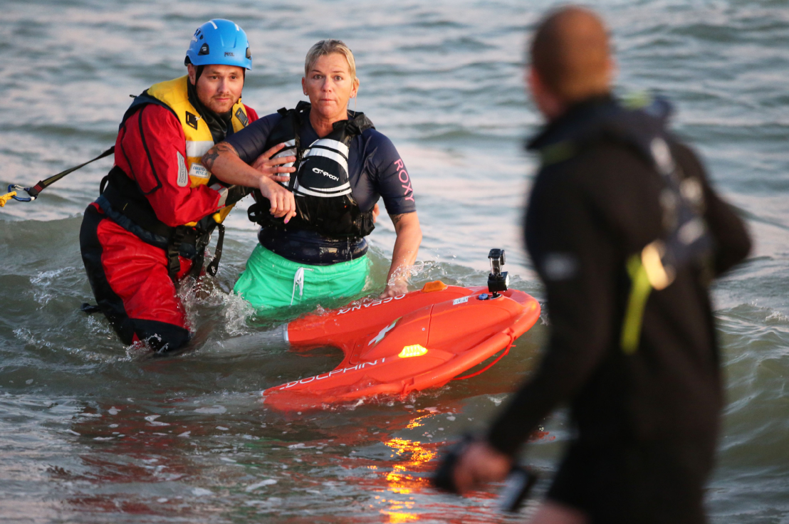 woman rescued by remote control lifebuoy Dolphin 1