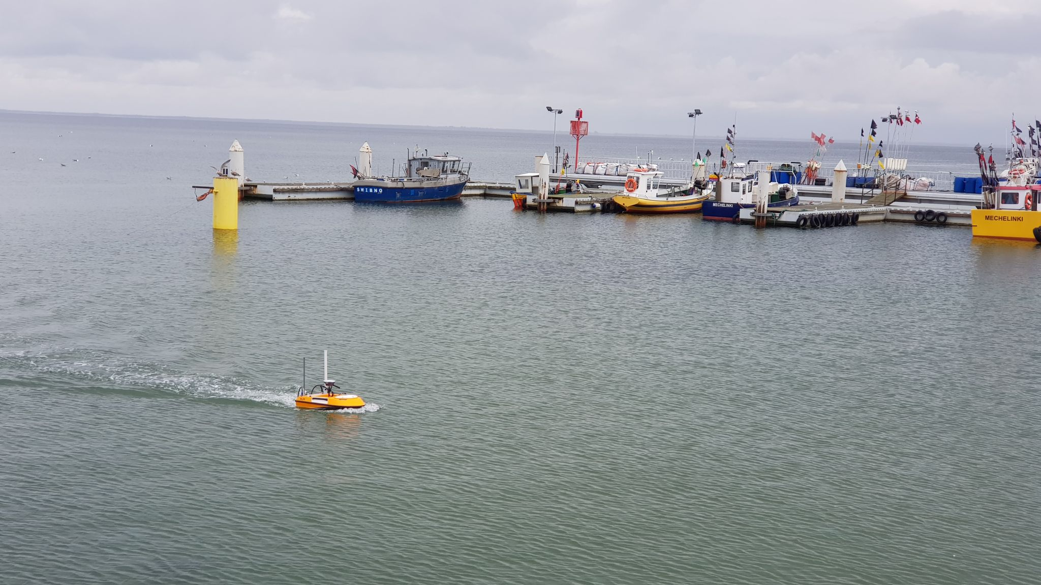 SL20 unmanned surface vehicle sailing near a dock